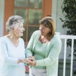 family member holding hands with senior loved one