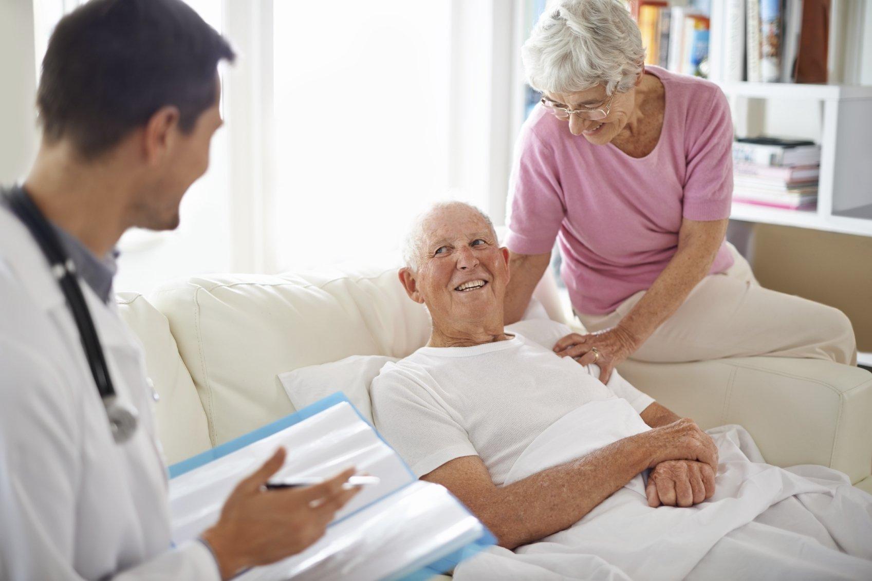 doctor speaking with senior man