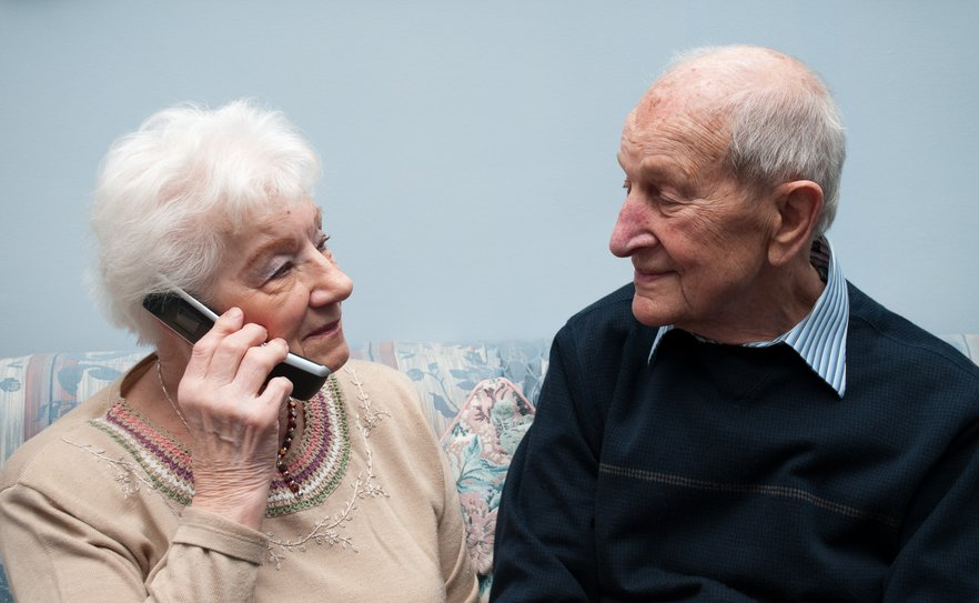 elderly couple talking on the phone