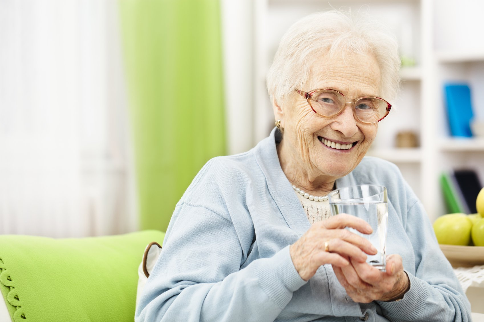 elderly woman drinking a glass of water