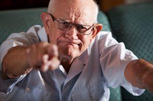 senior man pointing angrily