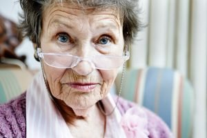 elderly woman in glasses