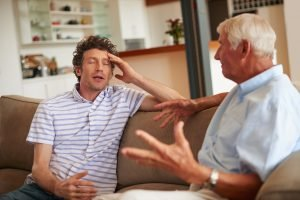 family caregiver arguing with senior loved one