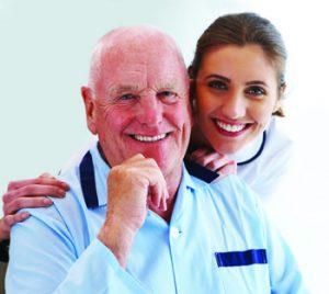 senior smiling with caregiver
