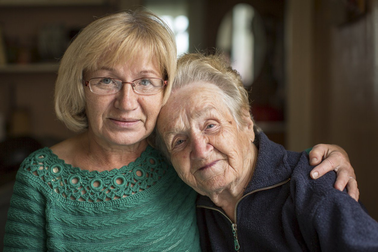 family caregiver with elderly family member