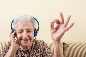 senior woman making okay sign while wearing headphones to listening music Grayson home health care agencies