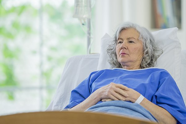 Senior woman in hospital bed.