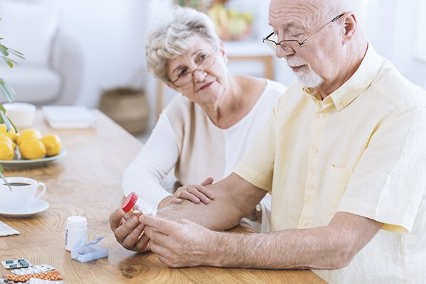Senior couple looking at medications.