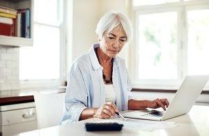 Senior woman with laptop.