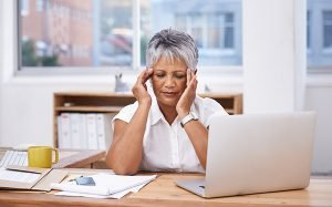Cropped shot of a mature businesswoman looking tired while sitting at her desk