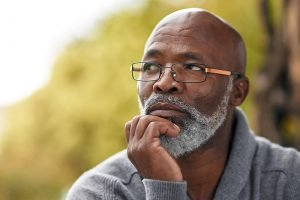 African american senior man posing thoughtfully