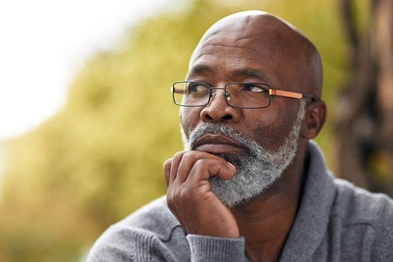 African american senior man posing thoughtfully
