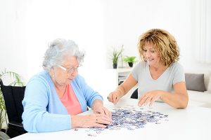family caregiver doing activities with senior loved one