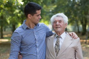 family caregiver helping senior with Alzheimer's confusion