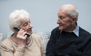 senior-couple-talking-on-phone