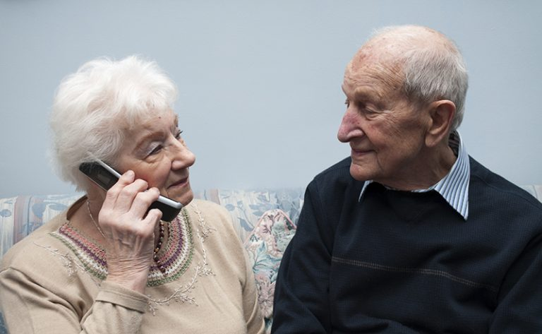 senior-couple-talking-on-phone