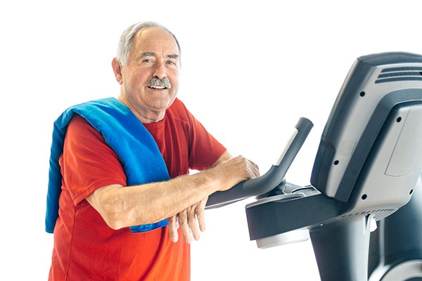 Elderly man performing exercise for people with Parkinson's.