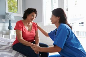caregiver comforting challenging behaviors due to Alzheimer's