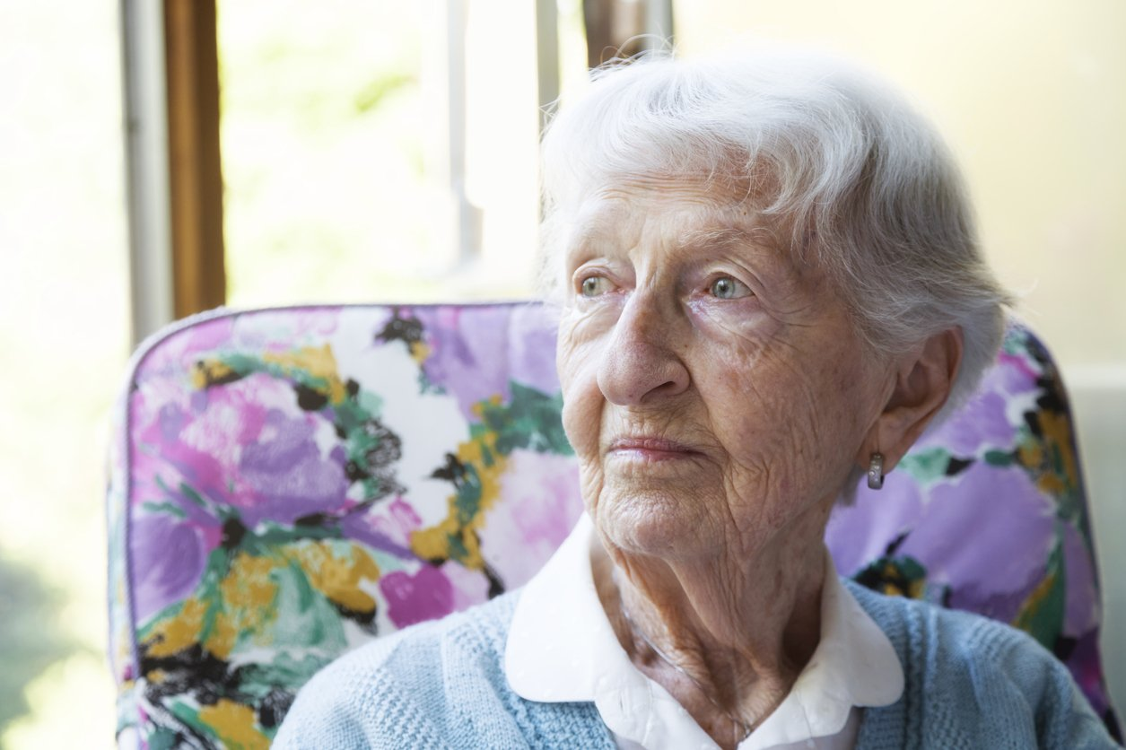Senior woman looking out the window